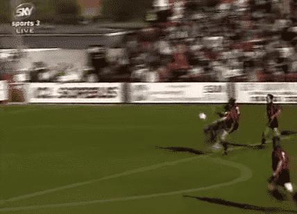 Gary Crawshaw lobs Woking goalkeeper Lawrence Batty