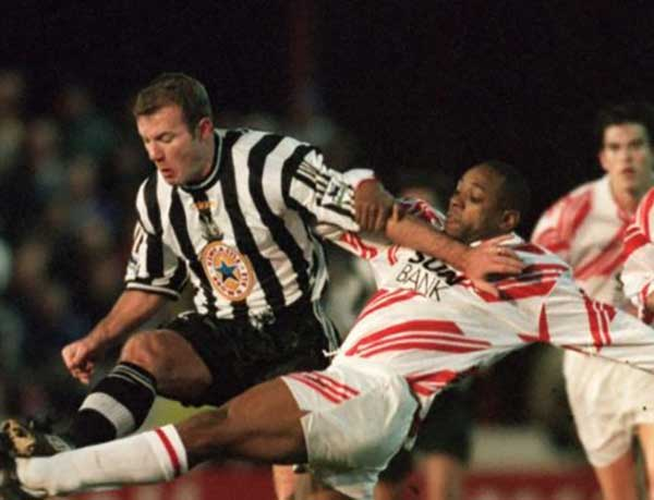 One of our finest centre halves, Mark Smith challenges Alan Shearer