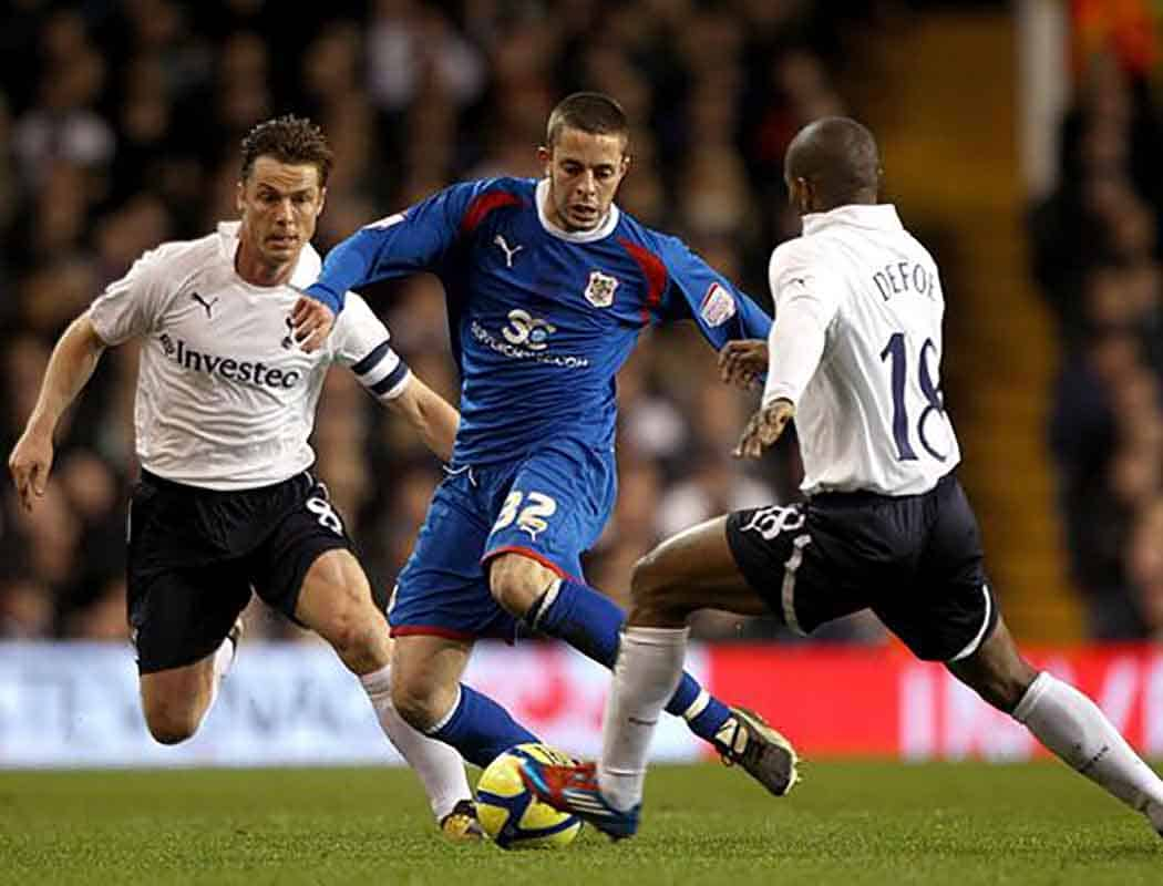 Robin Shroot in action against Tottenham Hotspur, 2012